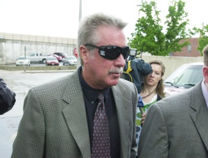 Drew Peterson walks out of the Will County Courthouse on Friday after a hearing regarding his felony gun charge.