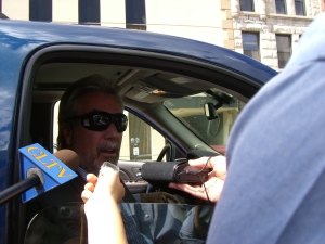 Drew Peterson speaks to reporters July 14 outside the Will County Courthouse after pleading not guilty to two felony weapons charges.