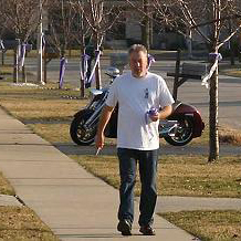 Drew Peterson cutting down ribbons honoring his missing wife on Sunday.