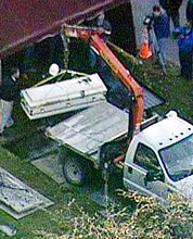 Authorities exhume the body of Kathleen Savio at Queen of Heaven Cemetery in Hillside, Ill.