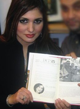 Reem Odeh posing with Derek Armstrong's book about the Peterson case